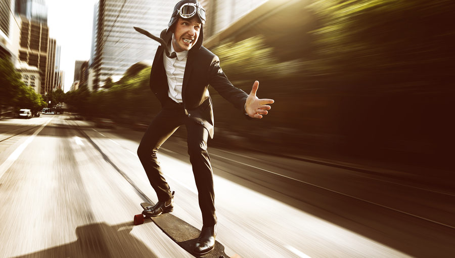 Businessman on speeding skateboard