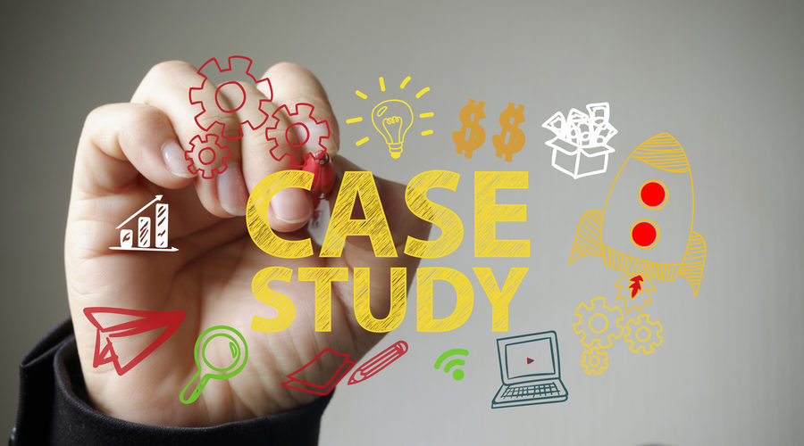 Hand writing CASE STUDY and business icons on transparent white board