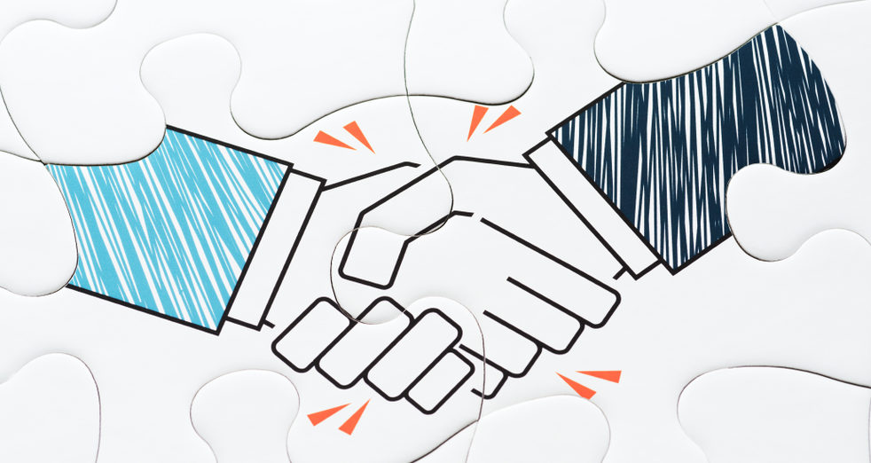 Drawing of two hands shaking hands, overlaid on on connected puzzle pieces.