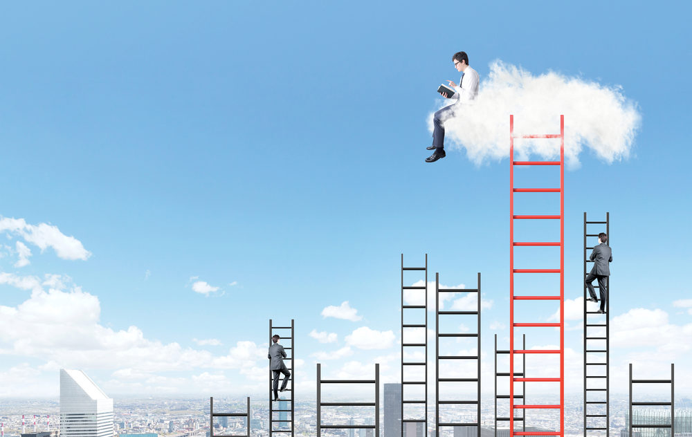 A businessman with a book sitting on a cloud over Paris, two businessman climbing several ladders to the blue sky under the cloud. Side view. Concept of dream and aspirations.