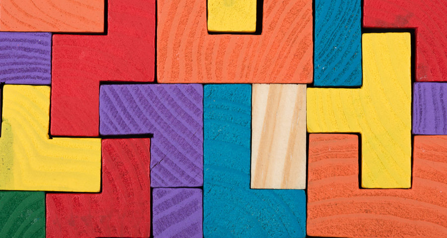 Colored jigsaw blocks puzzle. Business creative solution concept - jigsaw on the blackboard